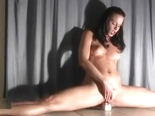 Sexy Brunette Gymnast Rides Her Dildo In A Special Pose