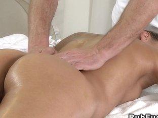Two Masseurs Giving Threesome Massage
