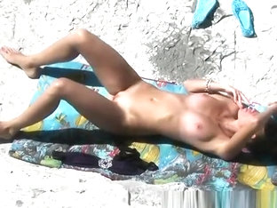 Tight Body Nudist Sunbathing And Smoking