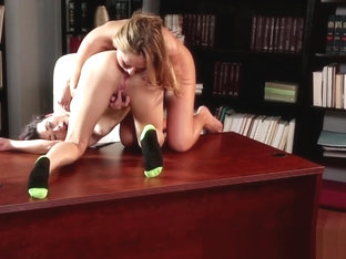 Dyke Beauties Oral Pleasuring On Top Of Desk