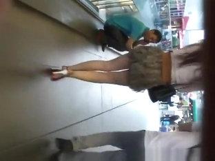 Sexy Legs Woman In Short Skirt Upskirt