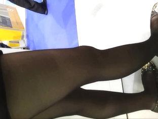 Shiny Black Panthose Girl In Super Mini Skirt