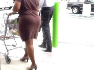 Sexy Ass In Short Brown Skirt..