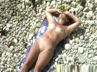 Nudist Woman In Rocky Beach Smoking