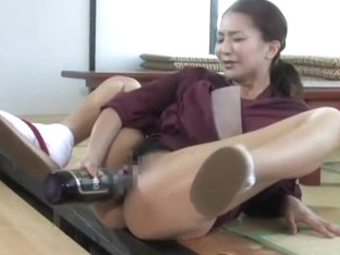 Japanese MILF Masturbates With A Bottle Beer