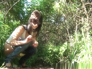 Hot Chick In Tight Jeans Pissing In The Woods