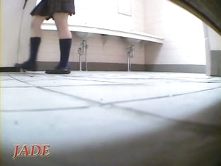 Frisky Schoolgirl Sits On Hunkers And Masturbates Up Skirt