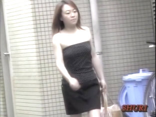 Man Pulls The Dress Of Japan Beauty Down