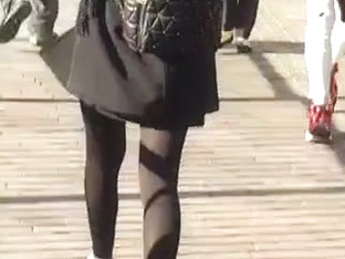 Mixed Race Lady In Skirt And Tights