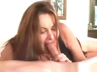Sexy Brunette Milf Blows Stiff Cock