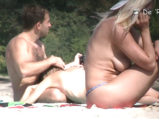 Exciting Beach Spycam Blonde Sunbathing Without Panty Or Bra