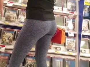 Girl In Gray Leggings At The Electronics Store