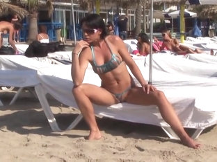 Hot Brunette MILF Posing In Sexy Bikini On Public Beach