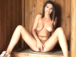 Sexy Brunette Stands In A Sauna And Finger Fucks Her Warm Twat