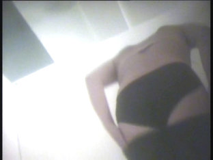 A MILF Teases Everybody With Her Juisy Tits In This Dressing Room Voyeur Video
