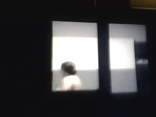 Woman Spied Topless Through Window