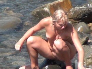 Sexy Blonde Washes Her Cute Face With Water From Sea