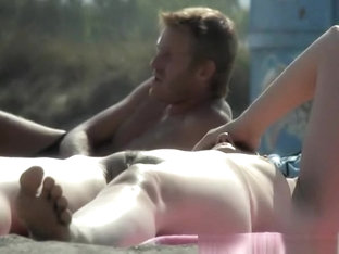 Nudist Woman Lying Down In The Sun Sunbathing
