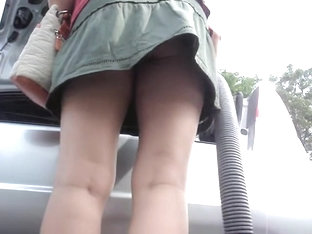 Girl Vacuum Cleaning The Car And Flashing Hot Upskirt