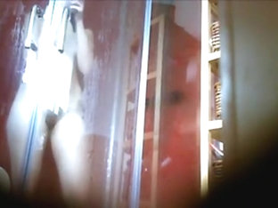 Voyeur Tapes A Girl Showering And Shaving Her Pussy