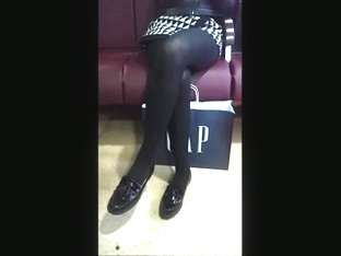 Girl In Black Opaque Tights And Super Mini Skirt