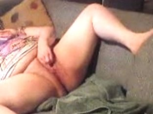 Chubby Masturbates On A Grey Couch