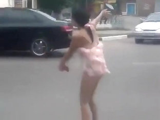 Drunk Girl Shows Off In The Evening On The Streets