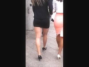 Woman In Pantyhose, Mini Skirt And High Heels