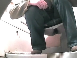 Woman In Jeans Peeing In Toilet