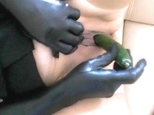 Fat Wife In Latex Uses A Veggie In Voyeur Masturbation Video