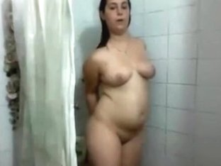 Chubby Girl Strips, Showers And Masturbates With The Showerhead.