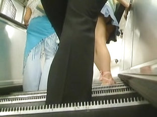 Amateur Upskirt And Tight Ass In Pants On The Stairs