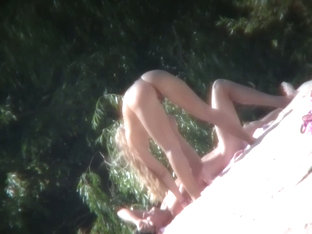 Nude MILF And An Acrobatic Bitch Move About On A Nudists Beach