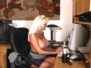 Busty Celeste Smoking And Playing At Her Desk