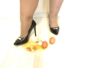 Crash Eggs In High-heeled Shoes