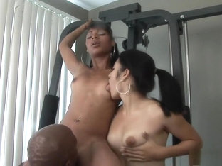 Petite Young Beauties Take Turns Fucking A Huge Black Cock In The Gym