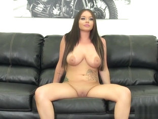 Buxom Young Girl Rachele Passionately Fucks A Large Pole On The Sofa