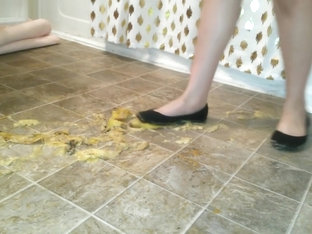 Suzi Walks Over Unpeeled Bananas, On Floor, Wearing Her Black Ballet Flats